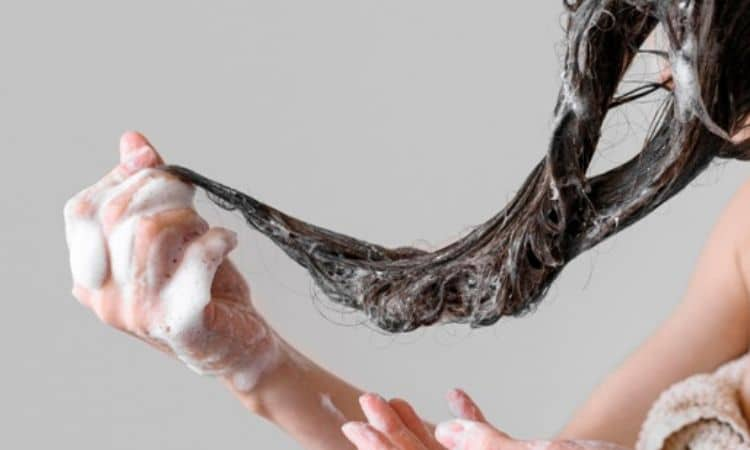 how often should you wash your hair woman